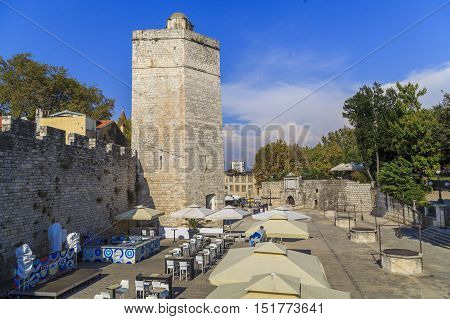 ZADAR, CROATIA - SEPTEMBER 14, 2016: Captain's Tower with ramparts are part preserved fortifications of the old city of Zadar.