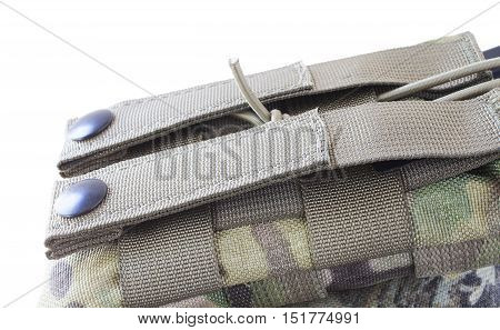 Strap and metal clasps used to attach a Ar-15 magazine pouch to webbing