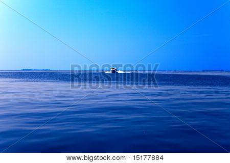 Boat at boundless ocean