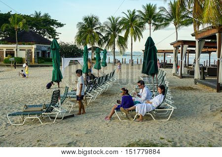 Kota Kinabalu,Sabah-Feb 4,2016:Happy tourists enjoy luxury sunset on the beach at Shangri-La's Tanjung Aru Resort & Spa,Kota Kinabalu,Sabah on 4th February 2016.Sabah popular among tourist destination