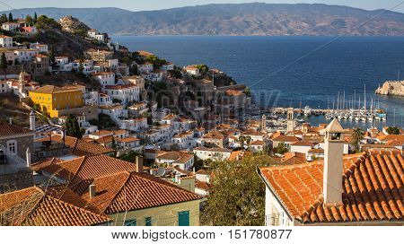Top view of Hydra island, yacht marina and the Aegean sea, Greece.