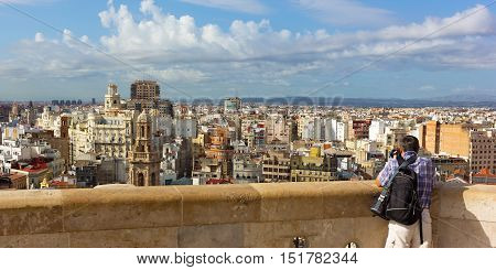 Valencia panorama from the observation deck of main city church. Photographer looking at urban panorama of European city.