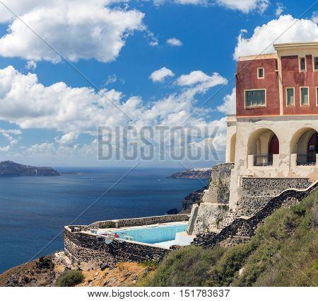 Greece Santorini island old abandoned house with pool