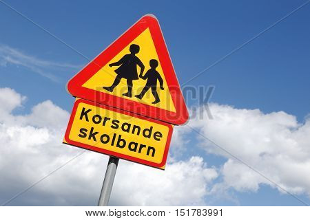 Swedish road sign warning for children with additional sign with the text