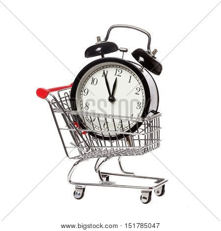 A shopping cart with an alarm clock that shows eleven fifty-five isolataed on white background.