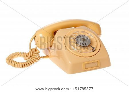 Yellow telephone with dial isolated on white background.