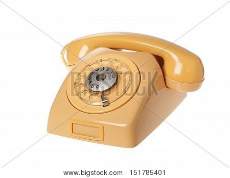 Yellow old Swedish 1960s telephone on hook with dial isolated on white background.
