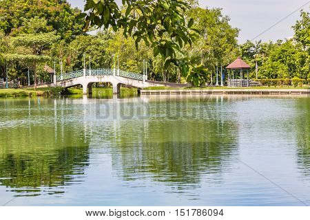 Bridge and gazebo beside the pond in public park