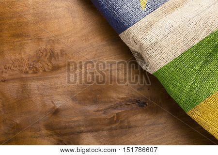 National Flag of the Central African Republic on the wooden background.