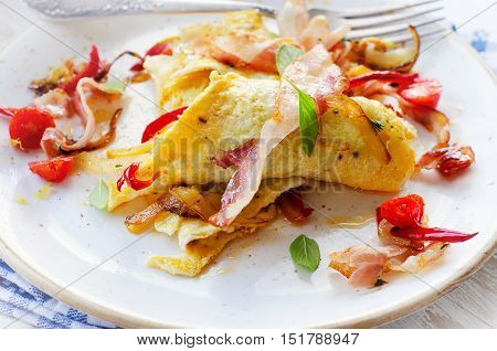 Omelet With Bacon And Vegetables For A Healthy Breakfast