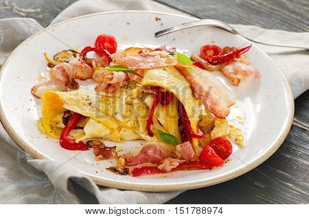 Omelet With Bacon And Vegetables