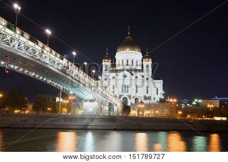 MOSCOW, RUSSIA - SEPTEMBER 06, 2016: The Cathedral of Christ the Savior and Patriarch bridge in september night. Historical landmark of the city  Moscow