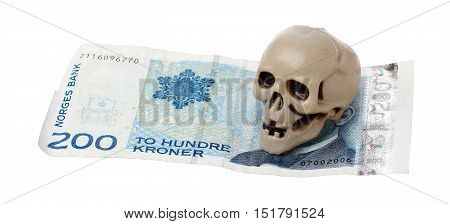 Norwegian 200 kroner bill with a small plastic scull isolated on white background.