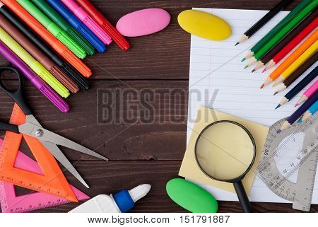 School stationery with copyspace on wooden board