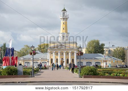 KOSTROMA, RUSSIA - SEPTEMBER 16, 2016: Old firehouse building with the tower on the Susanin square cloud september day. The historic center of Kostroma