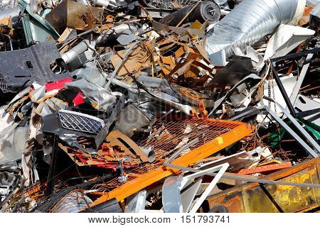 Close-up of pile with scrap metal at a recycling facility.