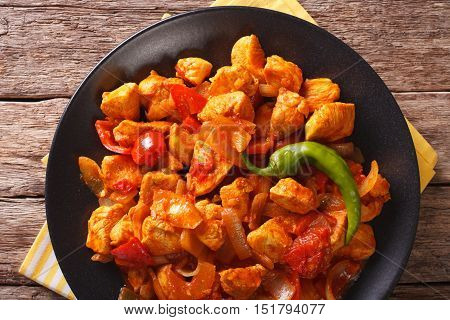 Chicken Jhalfrazi - Indian Cuisine With Pepper And Herbs Close-up. Horizontal Top View