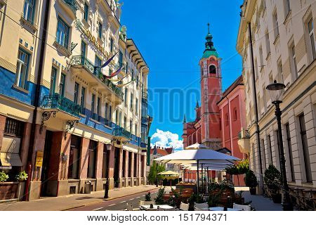 Ljubljana street view with cafe and church capital of Slovenia