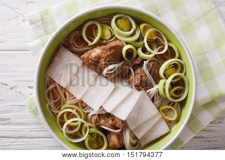 Galbitang Korean Soup With Beef Ribs, Rice Noodles And Daikon Close Up. Horizontal Top View