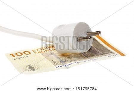 One white power plug on a one hundred Dannish banknote isloated on white.