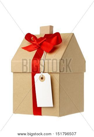 House wrapped in brown paper with red gift ribbon and white address label isolated on white background