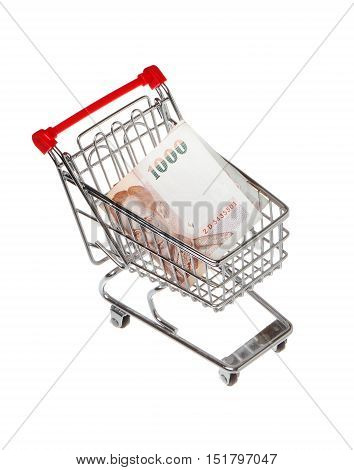 One small shopping cart containing a 1000 Thai baht bill isolated on white.