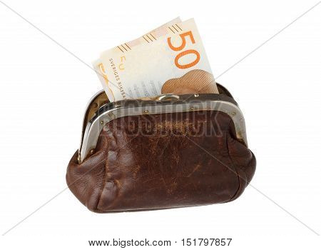Brown leather purse with one Swedish banknotesd fifty crowns visible isolated on white background.