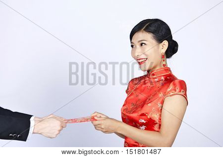 pretty chinese young woman receiving red pocket for happy chinese new year