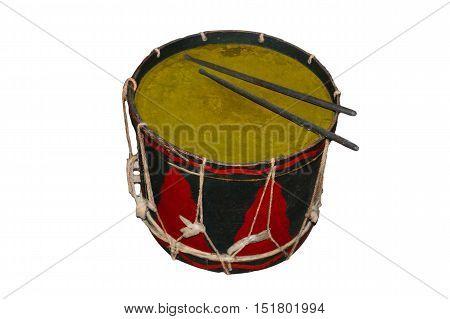 Antique black red tin drum against white background.