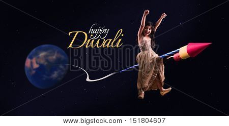 happy diwali greeting showing photograph of happy Indian small girl enjoying firecracker celebrating Diwali, cheerful girl sitting over firecracker or rocket and flying in the space in diwali festival