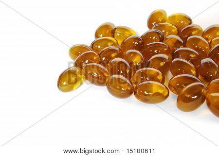 Brown Fish Oil Gel Capsule Pills Closeup