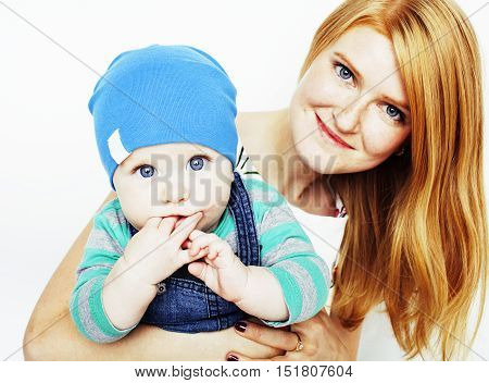 young beauty mother with cute baby, red head happy modern family smiling isolated on white background close up, lifestyle people concept