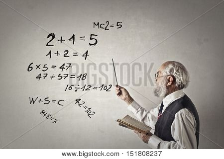 Maths teacher explaining to the classroom