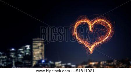 Heart glowing symbol . Mixed media