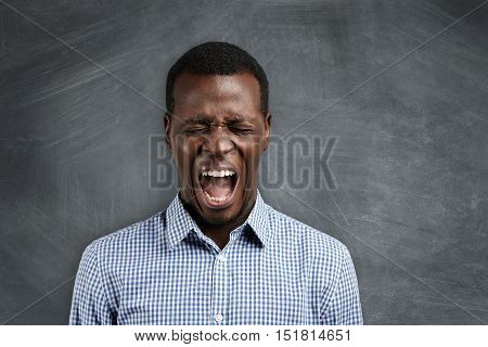 Shut Up! Headshot Of Annoyed Furious African High-school Teacher Yelling At His Disobedient Students