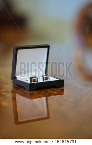 cufflinks on the black leather box in celebration day
