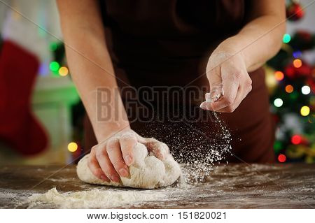 She puts the flour in the dough. Cooking Christmas food