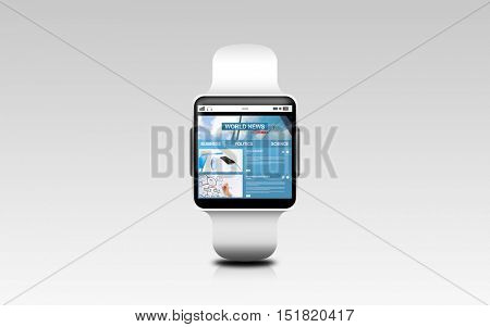 modern technology, mass media and object concept - close up of black smart watch with business news on screen over gray background