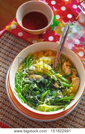 thai asian spicy soup with chicken ginger grass in bowl on the table