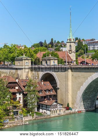 Bern Switzerland - May 26 2016: Medieval houses lining the banks of the Aare river in Bern (Unesco Heritage) the capital of Switzerland
