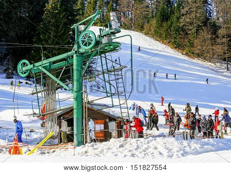 Gerardmer, France - Feb 19 - Group Of Skiers Standing In Line In Front Of Ski Lift During The Annual