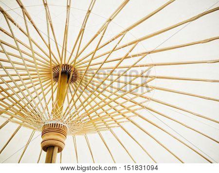 Thai Orient White paper umbrella with bamboo stalks