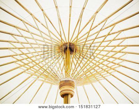 Thai Orient paper umbrella with bamboo stalks