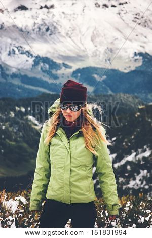 Woman Traveler hiking alone Travel Lifestyle adventure concept snow mountains on background active vacations