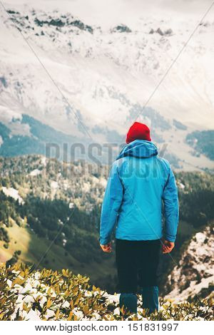 Traveler Man standing on cliff alone Travel Lifestyle aerial view mountains landscape adventure vacations outdoor wild nature