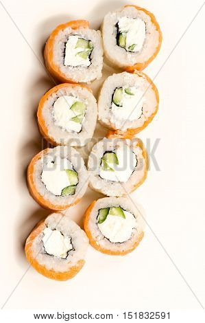 delicious sushi rolls from above isolated on white