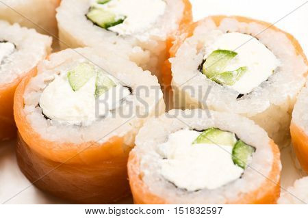 sushi rolls from above closeup isolated on white