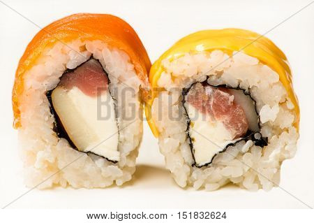 two multicolored sushi rolls close up isolated