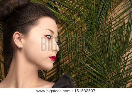profile face attractive young Korean girl with tropical bushes