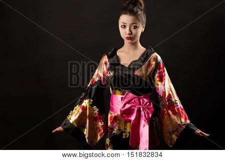 young beautiful girl in Japanese clothes isolated